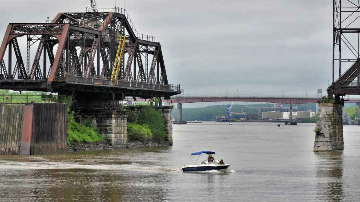 Work crews open the Livingston Avenue Bridge in this photo from 2011. Passenger rail advocates say they're concerned the 120-year-old bridge could fail, cutting off rail passenger service upstate beyond Rensselaer. (John Carl D'Annibale / Times Union)