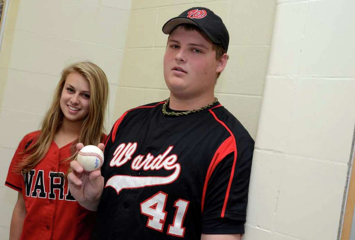 Fairfield Warde's baseball player Lance Kreizer and softball player Kitty Caissy. Kreizer is holding the game ball in which he pitched a no hitter.