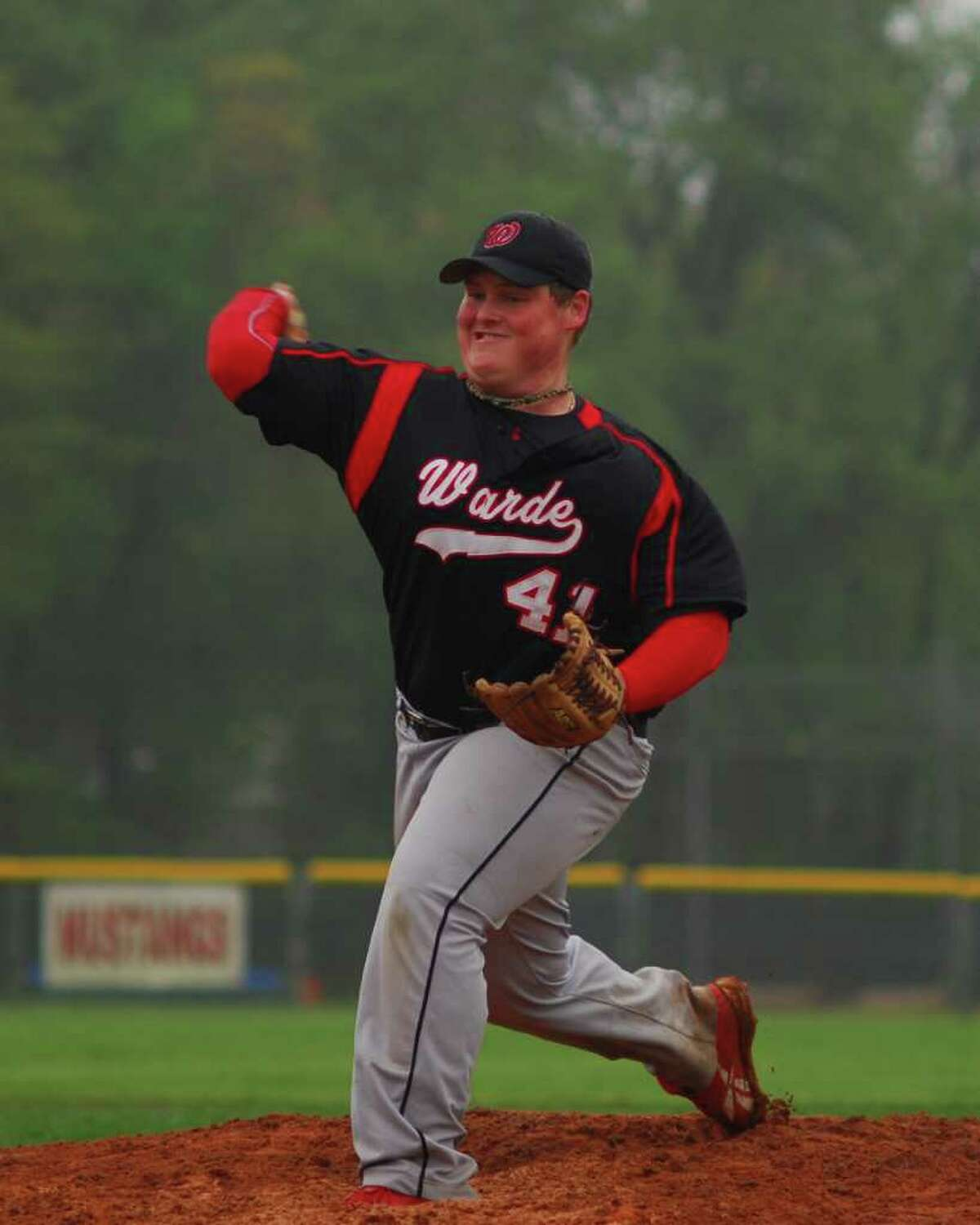 Fairfield Warde pitcher Lance Kreizer fires home during the Mustangs' 15-0 win over Harding on Monday. Kreizer pitched a perfect game on May 9 against Bassick.