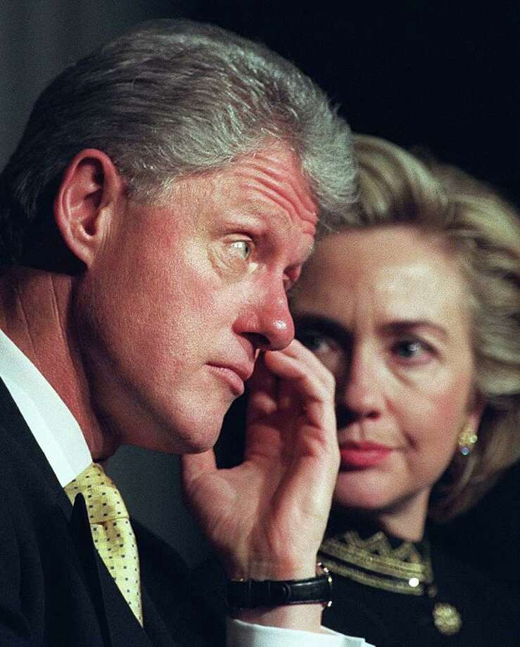 "Bill Clinton's dalliances with Monica Lewinsky left Americans baffled, and at the same time admiring, that Hillary would stand by her husband. ""The most difficult decisions I have made in my life were to stay married to Bill, and to run for the Senate from New York,"" Hillary said. She decided she wanted the marriage to last, if that was possible. Photo: JOYCE NALTCHAYAN, AFP/Getty Images / AFP"