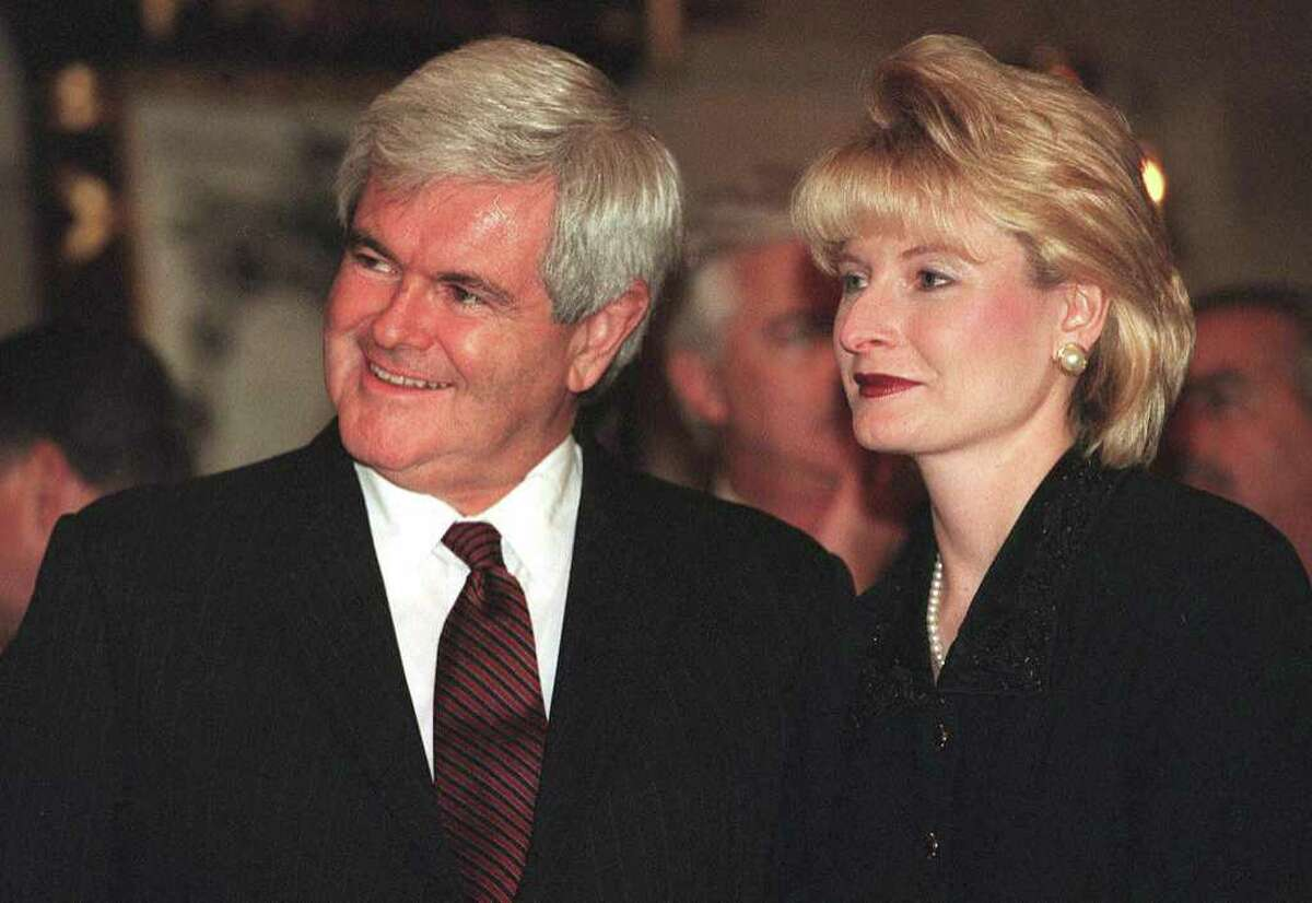 """Former House Speaker Newt Gingrich (L) and his wife Calista (R). Gingrich accuses Obama administration of waging """"war"""" on the Catholic Church and denounces Mitt Romney for having insisted that Catholic hospitals in Massachusetts """"give out abortion pills."""""""