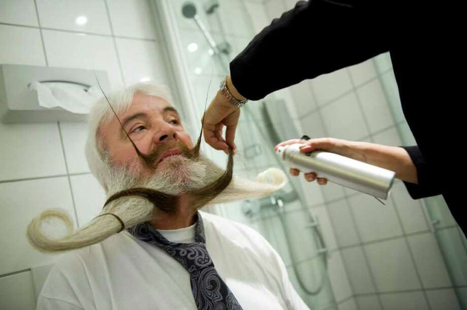 Couldn't make this year's World Beard and Moustache Championships, held Sunday, May 15, 2011 in Trondheim, Norway? Don't worry, we've got a full recap, starting with Germany's Pia Weis preparing husband Hans-Peter for the Full Beard Freestyle event. Photo: JONATHAN NACKSTRAND, AFP/Getty Images / 2011 AFP
