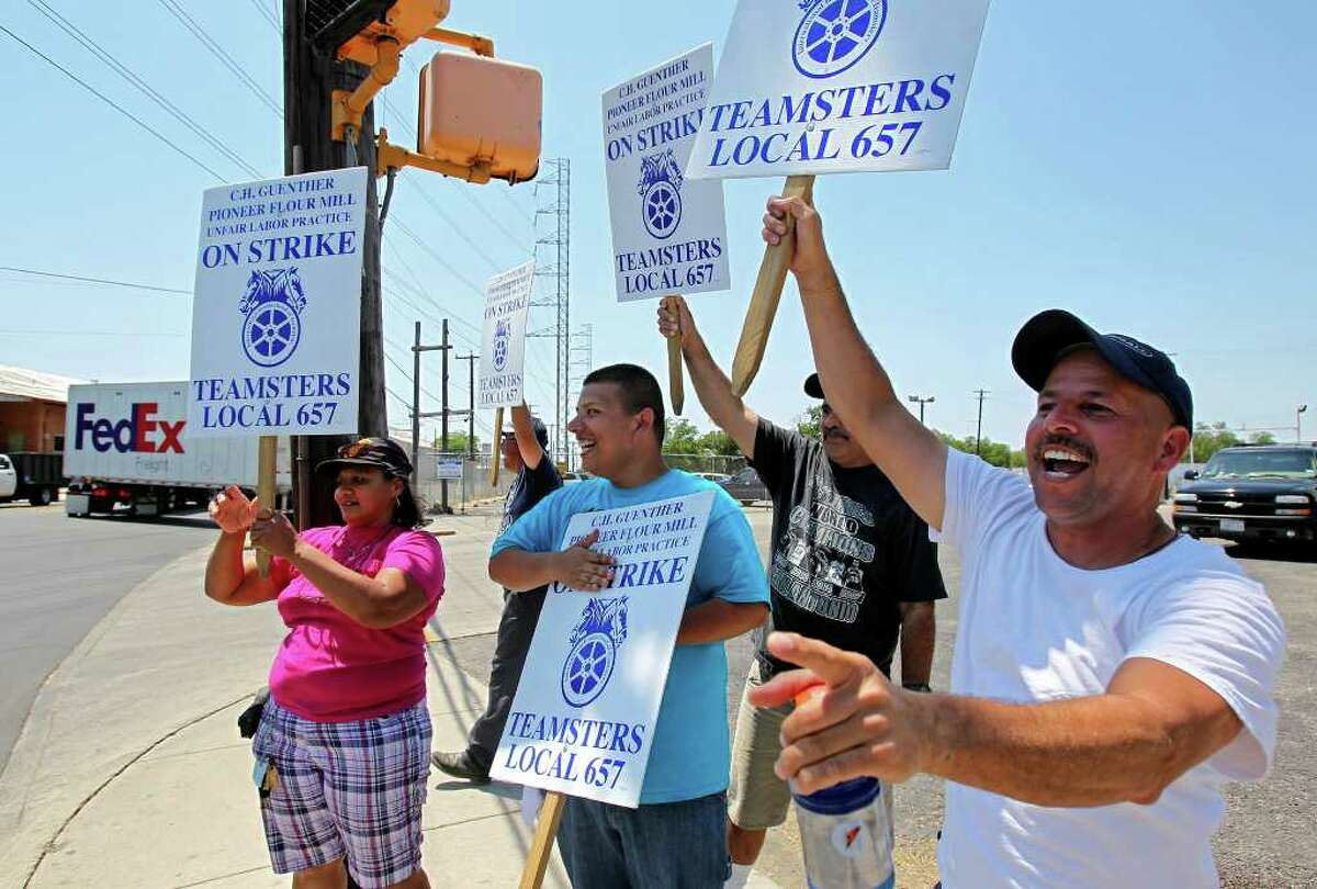 In this file photo, striking workers Loretta Ramirez (from left), Patrick Diaz, Patrick Cantu, Encarnacion Rodriguez and Simon Cantu demonstrate outside C.H. Guenther and Son Inc.