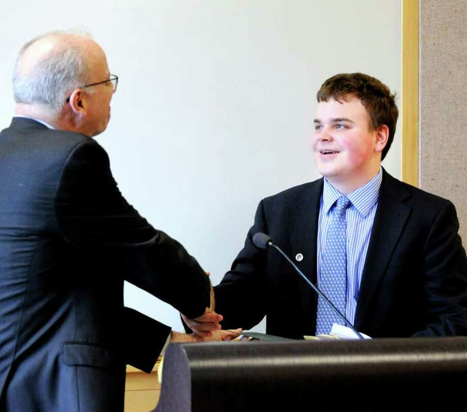 Greenwich Time editor David McCumber, shakes hands with Greenwich High School junior William Hallisey, who was named the first place winner of the second annual Defining Diversity Writing Contest.  The award ceremony, sponsored by Greenwich Time and the Town of Greenwich, was held at Greenwich Library, Tuesday afternoon, May 17, 2011. Photo: Bob Luckey, Greenwich Time / Greenwich Time