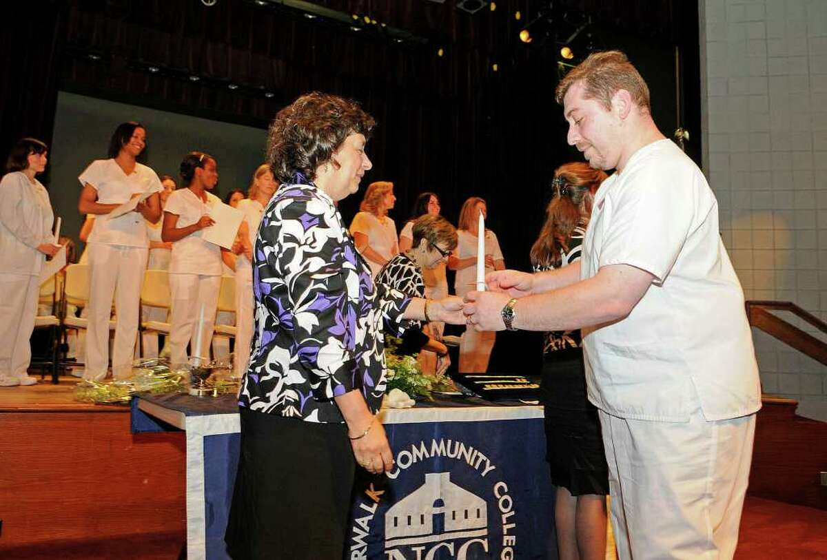 Slava Manevich, Stamford, receives a candle as the graduates of the Nursing Class of 2011 celebrate a Pinning Ceremony at the Pepsico Theater at Norwalk Community College in Norwalk, CT on Tuesday May 17, 2011.