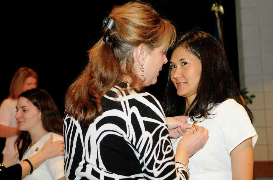 Evelyn Herrera, Stamford, receives her pin as the graduates of the Nursing Class of 2011 celebrate a Pinning Ceremony at the Pepsico Theater at Norwalk Community College in Norwalk, CT on Tuesday May 17, 2011. Photo: Shelley Cryan / Shelley Cryan freelance; Stamford Advocate freelance