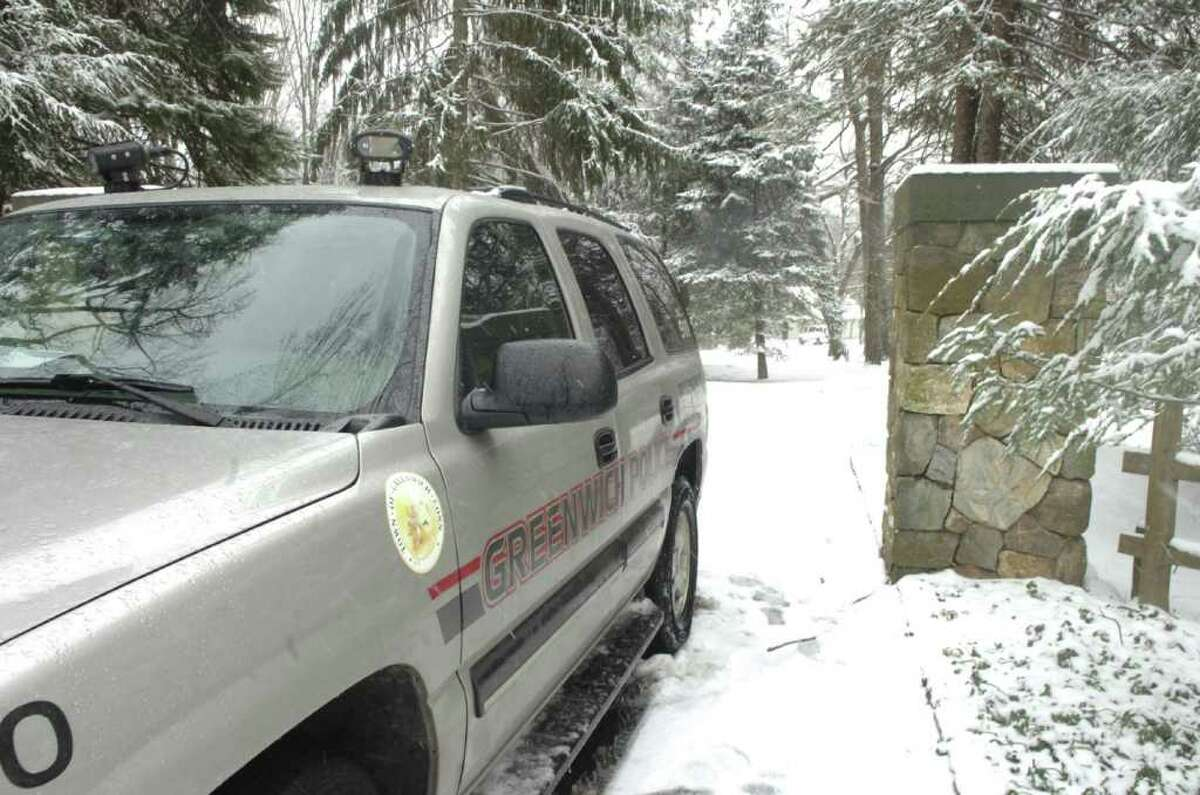 In this Dec. 31, 2009, file photo, a Greenwich police van is parked in front of 100 Sterling Road, the location of the killing of Amanda Dobrzanski. Her father, Adam Dobrzanski, who had been charged with first-degree murder, pleaded guilty Tuesday, May 17, 2011, to first-degree manslaughter and home invasion in the death.