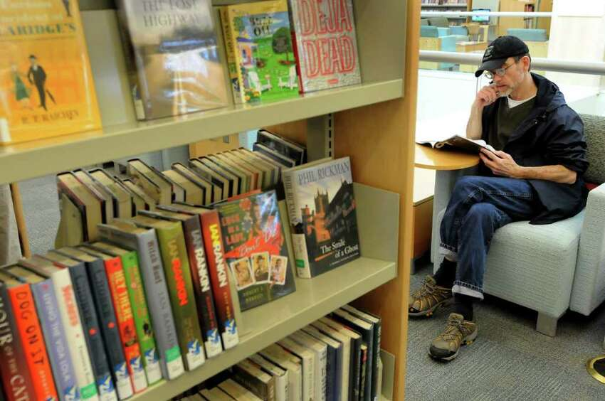 Larry Steffler of Rensselaer reads a magazine from the racks on Tuesday, May 17, 2011, at the Pine Hills Library in Albany, N.Y. (Cindy Schultz / Times Union)