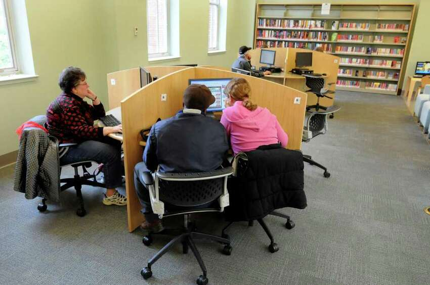 People use the computers on Tuesday, May 17, 2011, at the Pine Hills Library in Albany, N.Y. (Cindy Schultz / Times Union)