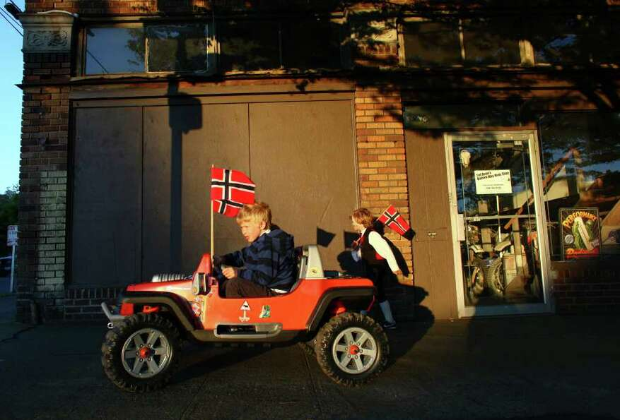 Benjamin Meyer, 6, drives his electric Jeep on 24th Avenue NW after Ballard's annual Syttende Mai Pa