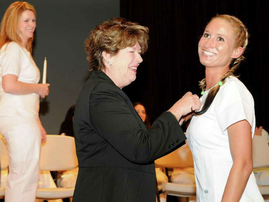 Yvonne Colton, Greenwich, receives her pin as the graduates of the Nursing Class of 2011 celebrate a Pinning Ceremony at the Pepsico Theater at Norwalk Community College in Norwalk, CT on Tuesday May 17, 2011. Photo: Shelley Cryan / Shelley Cryan freelance; Stamford Advocate freelance