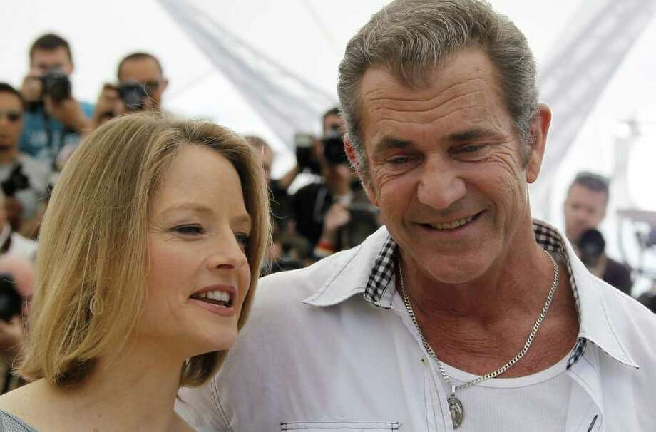 "US actor Mel Gibson and US director and actress Jodie Foster pose during the photocall of ""The Beaver"" presented out of competiton at the 64th Cannes Film Festival on May 18, 2011 in Cannes.            AFP PHOTO / FRANCOIS GUILLOT Photo: FRANCOIS GUILLOT, AFP/Getty Images / 2011 AFP"