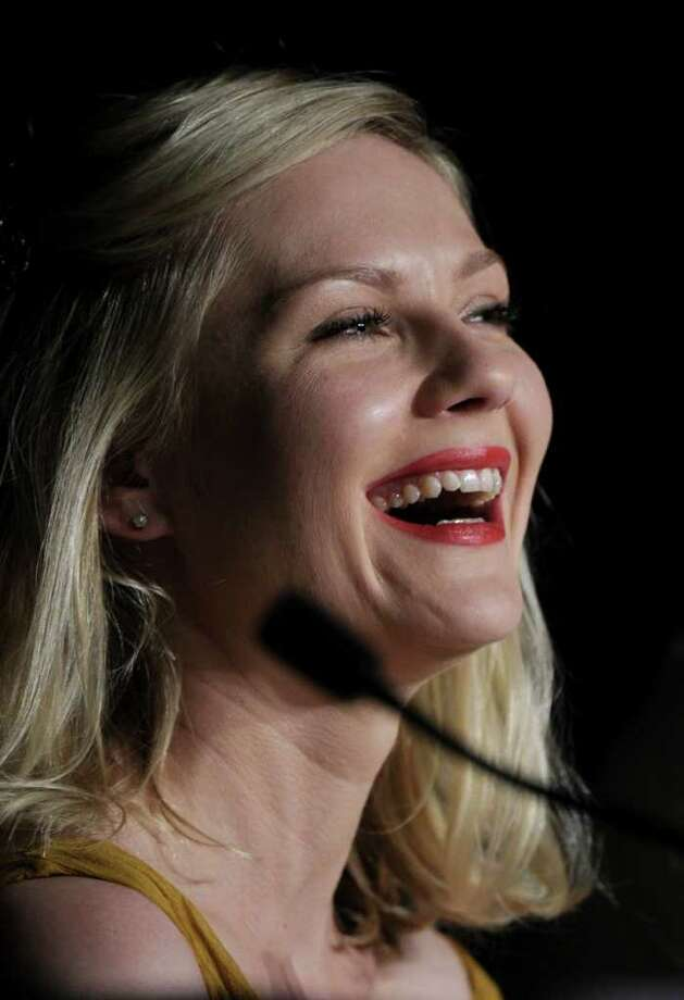 "Kirsten Dunst attends the press conference of ""Melancholia"" presented in competition at the 64th Cannes Film Festival on Wednesday in Cannes.        AFP PHOTO / ANNE-CHRISTINE POUJOULAT Photo: ANNE-CHRISTINE POUJOULAT, AFP/Getty Images / 2011 AFP"