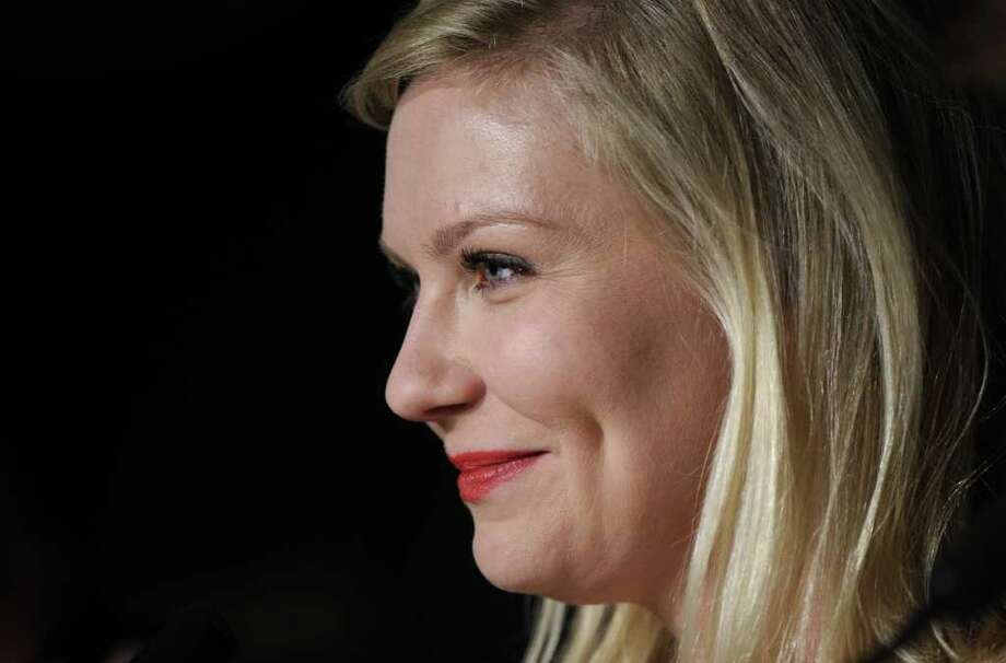 "US actress Kirsten Dunst attends the press conference of ""Melancholia"" presented in competition at the 64th Cannes Film Festival on Wednesday in Cannes.        AFP PHOTO / ANNE-CHRISTINE POUJOULAT Photo: ANNE-CHRISTINE POUJOULAT, AFP/Getty Images / 2011 AFP"