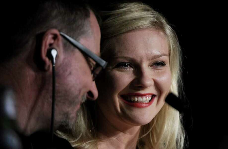 "Danish director Lars Von Trier and U.S. actress Kirsten Dunst attend at the press conference of ""Melancholia"" presented in competition at the 64th Cannes Film Festival on Wednesday in Cannes.        AFP PHOTO / ANNE-CHRISTINE POUJOULAT Photo: ANNE-CHRISTINE POUJOULAT, AFP/Getty Images / 2011 AFP"