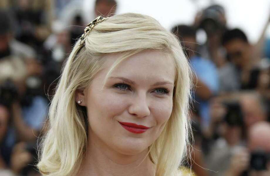 "Kirsten Dunst poses during the photocall of ""Melancholia"" presented in competition at the 64th Cannes Film Festival on Wednesday in Cannes.  AFP PHOTO / FRANCOIS GUILLOT Photo: FRANCOIS GUILLOT, AFP/Getty Images / 2011 AFP"
