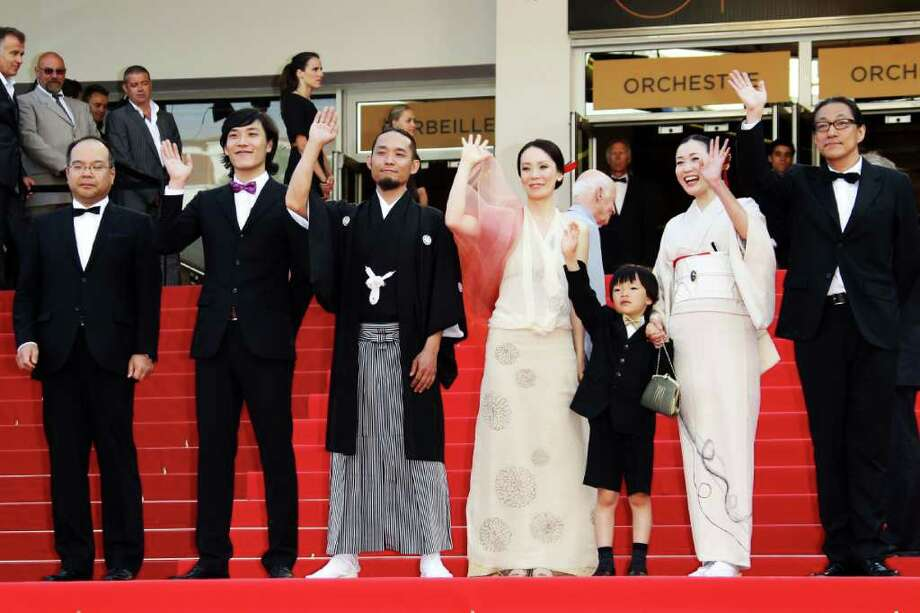 "CANNES, FRANCE - MAY 18:  (2L-R) Actor Taiga Komiz,Tohta Komizu, director Naomi Kawase and son with actress Hako Oshima and actor Tetsuya Akikawa attend the ""Hanezu No Tsuki"" premiere at the Palais des Festivals during the 64th Cannes Film Festival on May 18, 2011 in Cannes, France. Photo: Vittorio Zunino Celotto, Getty Images / 2011 Getty Images"