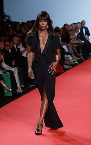 CANNES, FRANCE - MAY 16:  Model Naomi Campbell walks the runway at Fashion For Relief at Forville market during the 64th Annual Cannes Film Festival on May 16, 2011 in Cannes, France.  (Photo by Vittorio Zunino Celotto/Getty Images) Photo: Vittorio Zunino Celotto, Staff / 2011 Getty Images