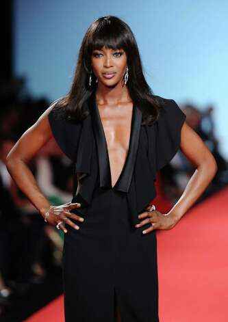 CANNES, FRANCE - MAY 16:  Model Naomi Campbell walks the runway at the Fashion For Relief at Forville market during the 64th Annual Cannes Film Festival on May 16, 2011 in Cannes, France.  (Photo by Ian Gavan/Getty Images) Photo: Ian Gavan, Stringer / 2011 Getty Images