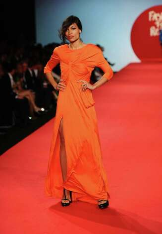 CANNES, FRANCE - MAY 16:  Actress Rosario Dawson attends Fashion For Relief at Forville market during the 64th Annual Cannes Film Festival on May 16, 2011 in Cannes, France.  (Photo by Ian Gavan/Getty Images) Photo: Ian Gavan, Stringer / 2011 Getty Images