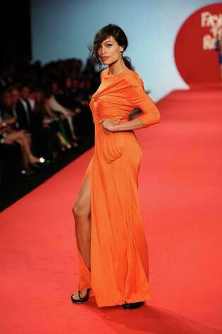 CANNES, FRANCE - MAY 16:  Actress Rosario Dawson walks the runway at the Fashion For Relief at Forville market during the 64th Annual Cannes Film Festival on May 16, 2011 in Cannes, France.  (Photo by Ian Gavan/Getty Images) Photo: Ian Gavan, Stringer / 2011 Getty Images