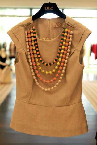 A Lela Rose crew neck fitted blouse with thread beaded necklace that sells for $795 is seen at Tootsies Wednesday, May 11, 2011, in Houston. ( Cody Duty / Houston Chronicle ) Photo: Cody Duty, Staff / © 2011 Houston Chronicle