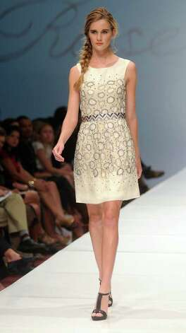 A model walks the runway wearing Lela Rose at the second day of the Fashion Houston 2010 presented by Audi at the Wortham Theater Tuesday Oct. 12, 2010. (Dave Rossman/For the Chronicle) Photo: Dave Rossman, Freelance / Freelance