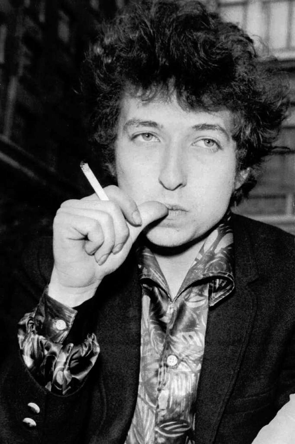 FILE--Singer Bob Dylan is seen in this April 27, 1965 file picture in London. Outraging some members of the Sixties generation, a major Canadian bank is using Dylan's 1964 protest anthem, 'The Times They Are A-Changin'' as the theme of its current public relations campaign. Fans are aiming their wrath not only at the bank of Montreal but also at Dylan. (AP Photo)