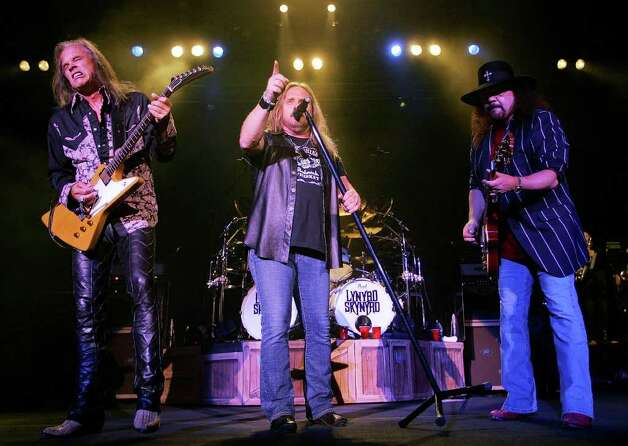 **FILE** Lynyrd Skynyrd lead singer Johnny Van Zant, center, guitarists Rickey Medlocke, left, and Gary Rossington, right, perform their familiar southern rock in Nashville, Tenn., on May 27, 2005.  The group, Black Sabbath, Miles Davis and the Sex Pistols are among five musical legends to be inducted into the Rock and Roll Hall of Fame, the organization announced Monday, Nov. 28, 2005.(AP Photo/John Russell) Photo: JOHN RUSSELL / AP