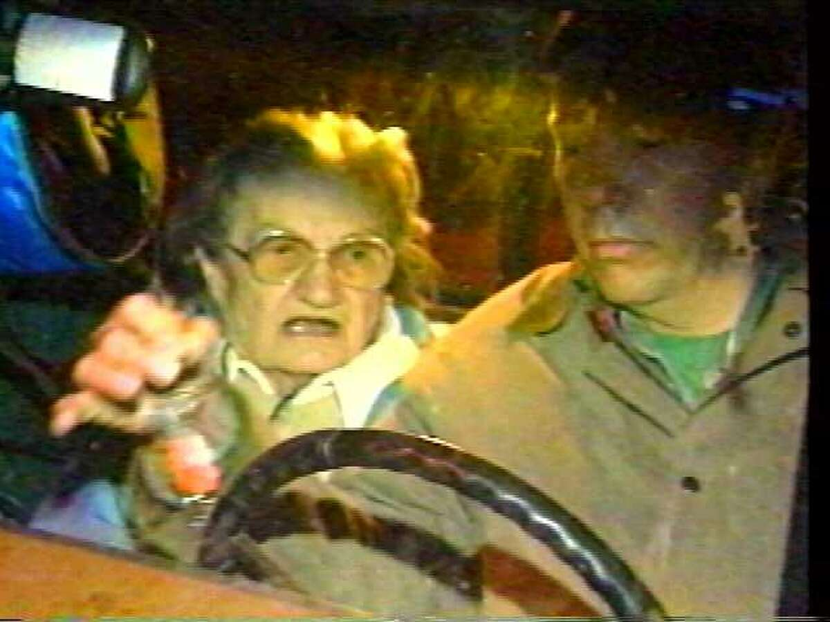Photo from video: Wanda Kaczynski and her son David Kaczynski as they leave Wanda Kaczynski's Glenville apartment early on April 4,1996. They are the mother and brother of Theodore Kaczynski. (WRGB video)