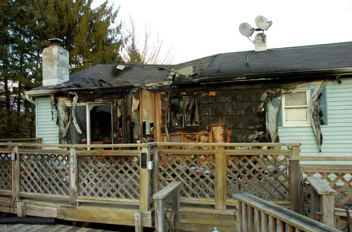 The Dos Santos home on Possum Drive in New Fairfield, which was recently destroyed by a fire, is shown Dec. 22, 2010.