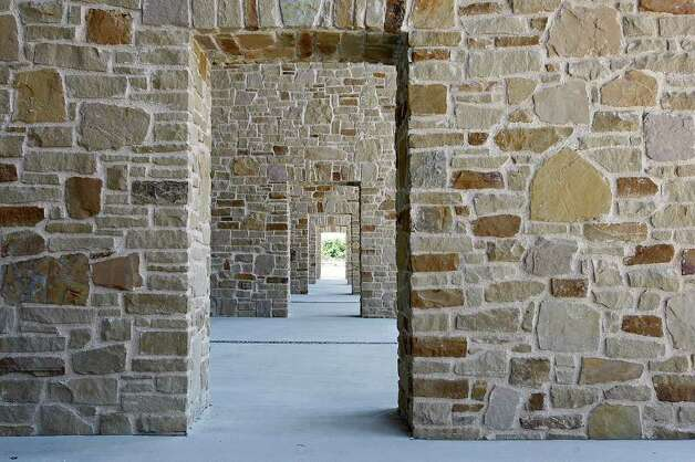 METRO -- San Saba sandstone is used on the arches of the South Courtyard of the newly-opened Mission Branch Library, Tuesday, May 17, 2011. JERRY LARA/glara@express-news.net Photo: JERRY LARA, San Antonio Express-News / SAN ANTONIO EXPRESS-NEWS