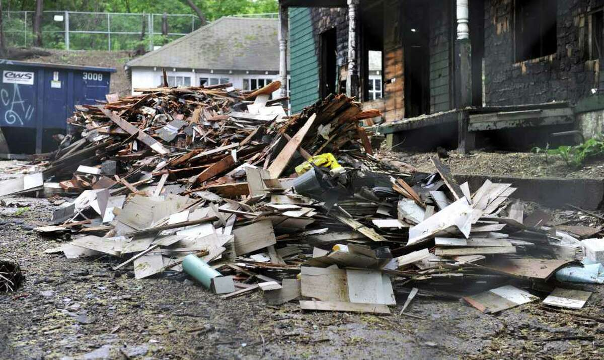 A large pile of construction debris that was dumped recently at a blighted property near Rose Street. The owner is planning to develop low income rental housing on the site and is offering a reward for any information leading to the identity of the person responsible for the dumping.