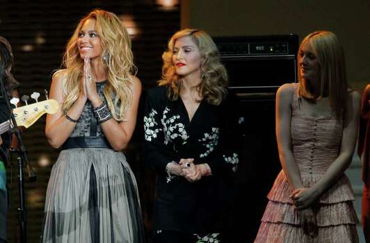 "Beyonce, Madonna and Dakota Fanning  appear during a star-studded double-taping of ""Surprise Oprah! A Farewell Spectacular,"" Tuesday, May 17, 2011, in Chicago. ""The Oprah Winfrey Show"" is ending its run May 25, after 25 years, and millions of her fans around the globe are waiting to see how she will close out a show that spawned a media empire. Photo: AP"