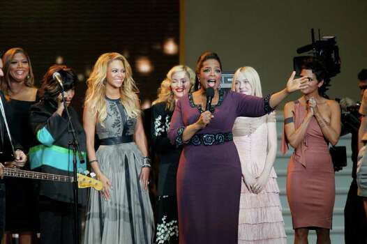 "Oprah Winfrey speaks as she is surrounded by Patti LaBelle, left, Beyonce Madonna, Dakota Fanning and Halle Berry during a star-studded double-taping of ""Surprise Oprah! A Farewell Spectacular,"" Tuesday, May 17, 2011, in Chicago. ""The Oprah Winfrey Show"" is ending its run May 25, after 25 years, and millions of her fans around the globe are waiting to see how she will close out a show that spawned a media empire. Photo: AP"
