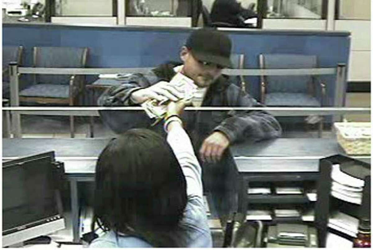 Surveillance photo of the man Newtown Police said robbed the Chase Bank on Church Hill Road.