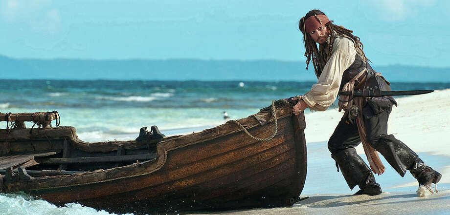 "Capt. Jack Sparrow (Johnny Depp) attempts a getaway in ""Pirates of the Caribbean: On Stranger Tides."" DISNEY ENTERPRISES / ©Disney Enterprises, Inc. All Rights Reserved."