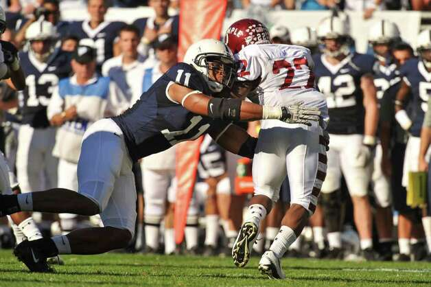 Penn State linebacker Khairi Fortt tackles Temple's Matt Brown during a game last season. Photo: Mark Selders;Contributed Photo, Penn State University/Contributed Photo / ©2010 Mark Selders/Penn State Athletic Communications