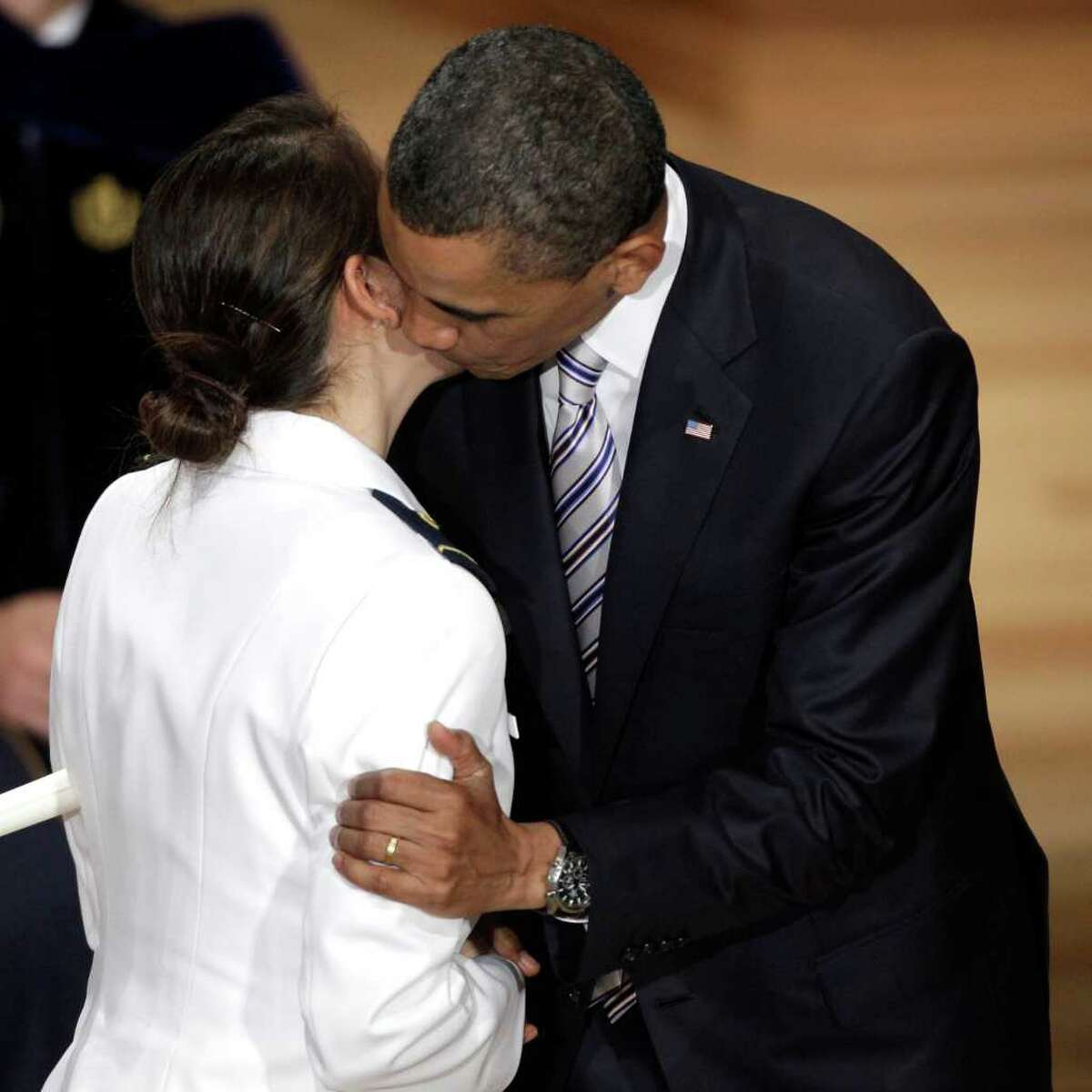 President Barack Obama kisses Ensign Jennifer Proctor after he presented her with her commission at the 130th Coast Guard Academy Commencement in New London, Conn., Wednesday, May 18, 2011. Proctor and Obama graduated from the same Hawaiian high school. (AP Photo/Stephan Savoia)