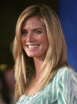 """LOS ANGELES, CA - APRIL 16:  Model/actress Heidi Klum arrives at the Premiere Of The Weinstein Company's """"Hoodwinked Too! Hood Vs. Evil In 3D"""" on April 16, 2011 in Los Angeles, California.  (Photo by Valerie Macon/Getty Images) *** Local Caption *** Heidi Klum Photo: Valerie Macon, Getty Images / 2011 Getty Images"""