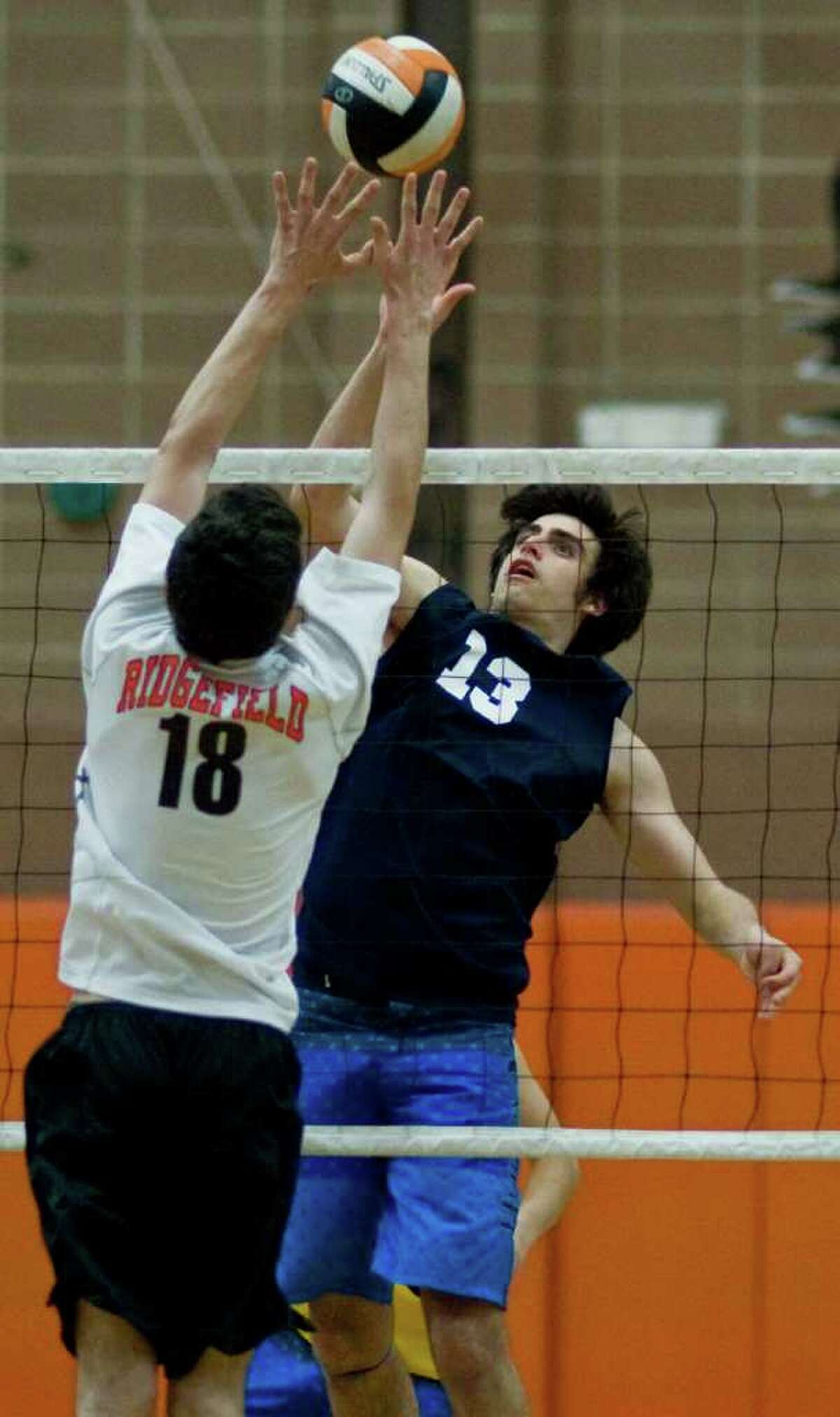 Ridgefield's Alex Gasdia tries to block a shot from Staples Jonah Aelyon during a game at Ridgefield High School. Wednesday, May 18, 2011
