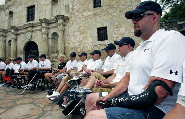 Wounded veterans listen to speakers as Segs4Vets presents mobility devices to severely wounded troops at ceremony at the front of the Alamo  on May 18, 2011. Photo: TOM REEL, SAN ANTONIO EXPRESS-NEWS / treel@express-news.net