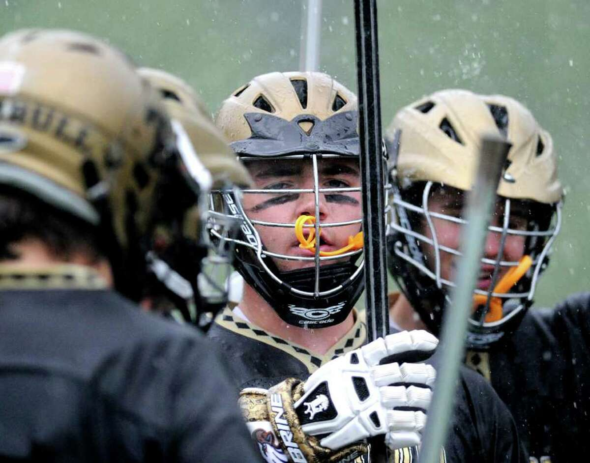 Trumbull High School huddles in the rain during boys high school lacrosse game between Greenwich High School and Trumbull High School at Greenwich High School, Wednesday afternoon, May 18, 2011.