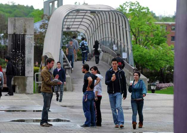 Students walk on the RPI campus on Wednesday, May 18, 2011, in Troy, NY. An RPI student was diagnosed with the measles.( Philip Kamrass / Times Union) Photo: Philip Kamrass