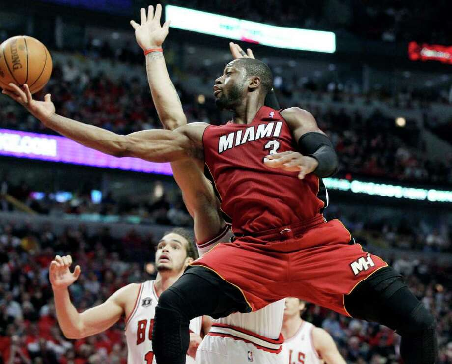 Miami Heat guard Dwyane Wade (3) goes up for a shot against Chicago Bulls forward Taj Gibson (obscured) during the second quarter of Game 2 of the NBA basketball Eastern Conference finals on Wednesday, May 18, 2011, in Chicago. (AP Photo/Nam Y. Huh) Photo: Nam Y. Huh