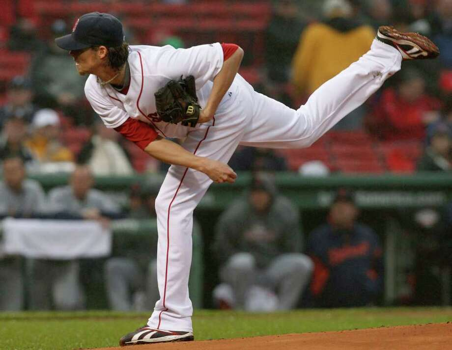 Boston Red Sox starting pitcher Clay Buchholz delivers to the Detroit Tigers in the first inning of a baseball game at Fenway Park in Boston, Wednesday, May 18,  2011. (AP Photo/Elise Amendola) Photo: Elise Amendola