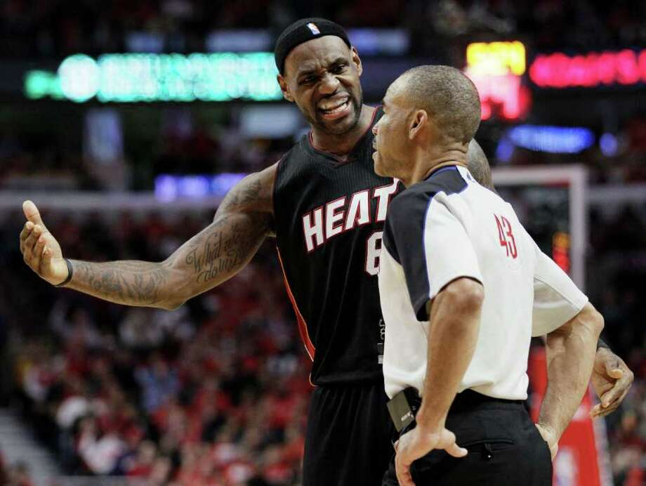 Miami Heat's LeBron James, left, reacts as he talks to official Dan Crawford during the fourth quarter against the Chicago Bulls in Game 1 of the NBA Eastern Conference finals basketball series  Sunday, May 15, 2011 in Chicago. The Bulls won 103-82. (AP Photo/Nam Y. Huh) Photo: Nam Huh