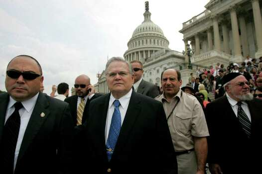 METRO - Surrounded by his security team, left, and San Antonio Rabbi Aryeh Scheinberg of Rodfei Shalom Synagogue, far right, San Antonio Pastor John Hagee, center, leaves the United States Capitol building after posing for a group picture with Christians United for Israel's Texas delegates after the delegates spent the day lobbying for Israel at the Capitol on Wednesday, July 18, 2007. Lisa Krantz/STAFF Photo: LISA KRANTZ, SAN ANTONIO EXPRESS-NEWS / SAN ANTONIO EXPRESS-NEWS