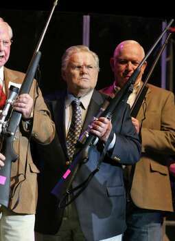 "Rev. John Hagee holds a rifle he presented to a soldier wounded in the Iraq war, during the Clay Walker performance at the AT&T Center for his first stop on a three city ""Honor Our Heroes Tour"", Thursday, Nov. 15, 2007.  Photo: Bob Owen, SAN ANTONIO EXPRESS-NEWS / SAN ANTONIO EXPRESS-NEWS"