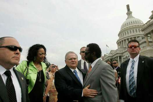 San Antonio Pastor John Hagee, center/left, embraces Dr. LaSalle Vaughn, Pastor at New life Christian Center in San Antonio and the San Antonio Director of Christians United for Israel, center/right, center, at the United States Capitol building after posing for a group picture with Christians United for Israel's Texas delegates after the delegates spent the day lobbying for Israel at the Capitol on Wednesday, July 18, 2007.  Photo: LISA KRANTZ, SAN ANTONIO EXPRESS-NEWS / SAN ANTONIO EXPRESS-NEWS